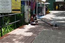 Aboriginal didgeridoo player on the streets of Kuranda