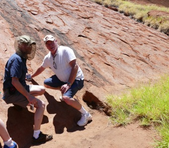 Touching scared Uluru